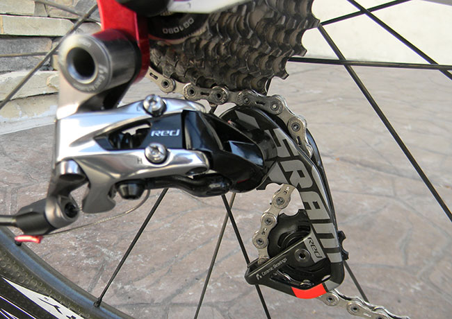 - The rear derailleur is the SRAM Red road derailleur. This is consistently rated as the best cable-actuated derailleur available. Ultra precise, super lightweight and nearly silent.